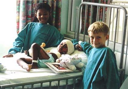 Thobe & Tristan visiting an orphaned burns victim